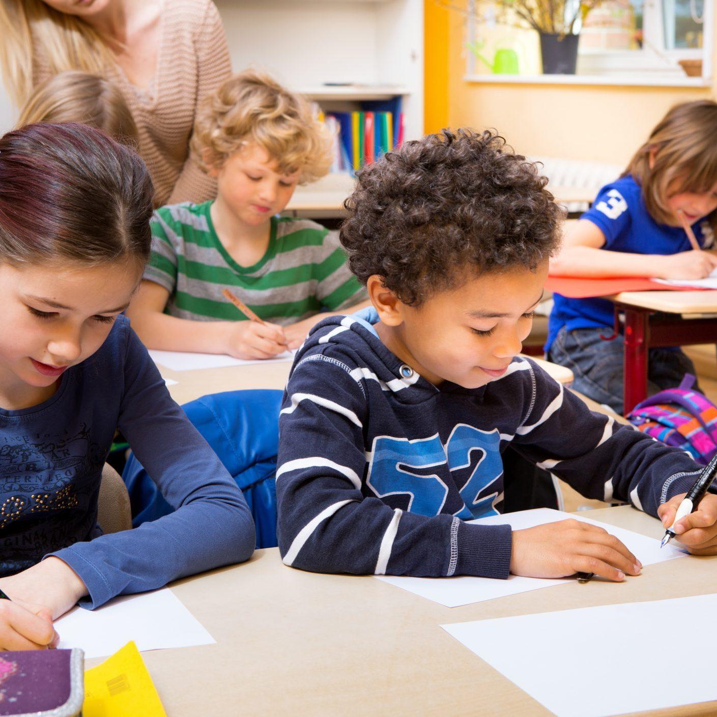 Classroom of children doing school work
